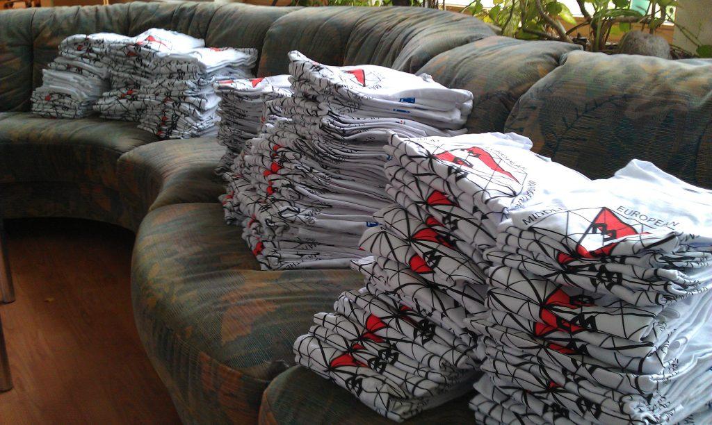 A big pile of MEMO T-shirts